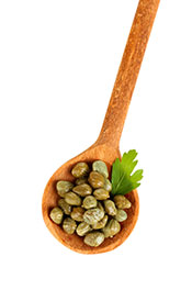 A Handful of Capers On a Wooden Spoon.