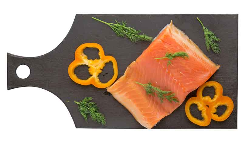 A Fresh Red Trout On a Wooden Board.