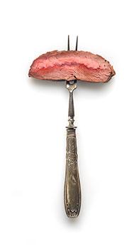 A Piece of Ribeye Steak on a Fork.
