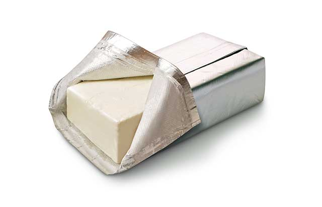Bar of Cream Cheese In Foil Wrap Packaging.