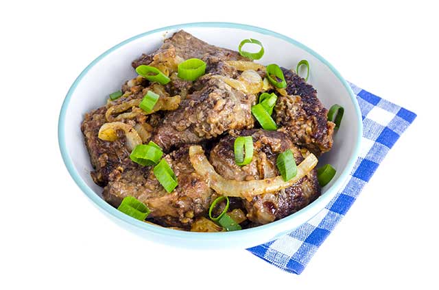 Bowl of Cooked Beef Liver With Onions.