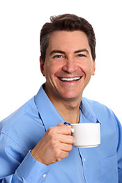 Smiling Business Man Wearing Formal Shirt Holding Cup of Coffee.