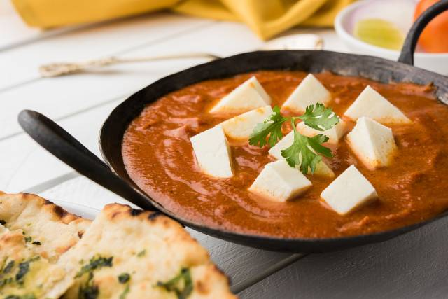 A Curry Featuring Cubes of Paneer Cheese.