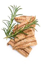 Several Cooked Mackerel Fillets With a Sprig of Rosemary.