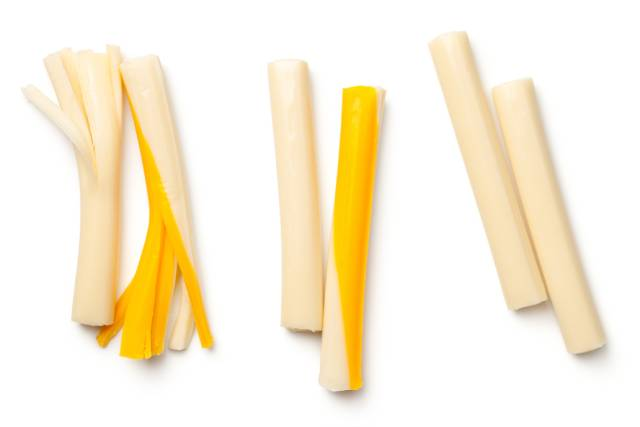 Cream and Orange Colored Sticks of String Cheese.