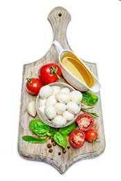 Fresh Italian Mozzarella Cheese On a Wooden Board With Tomatoes.