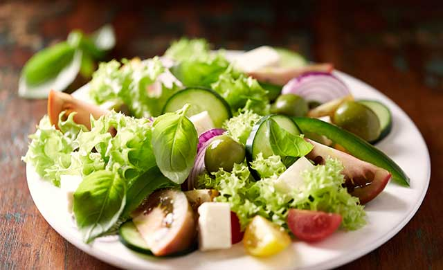 A Greek Salad Featuring Feta Cheese and Castelvetrano Olives.