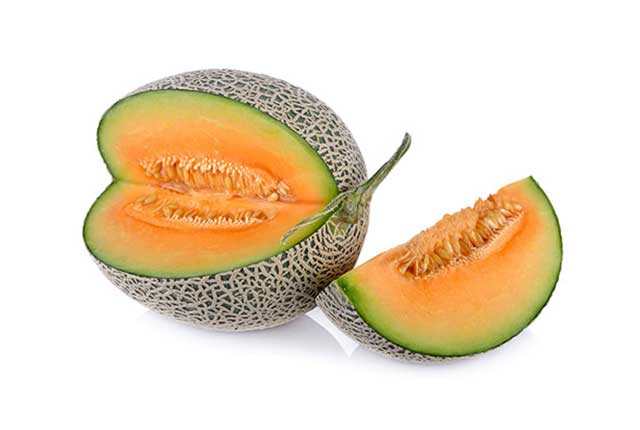 A Cantaloupe Melon On a White Background With One Slice Missing.