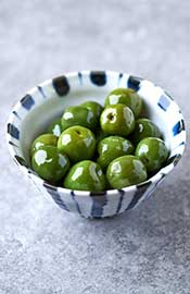 A Close-up View of Castelvetrano Olives in a Bowl.