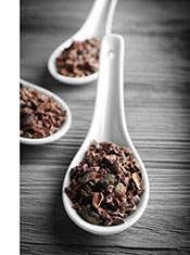 Cocoa Nibs On a Large White Spoon.