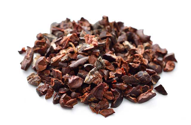 Cocoa Nibs On a White Background.
