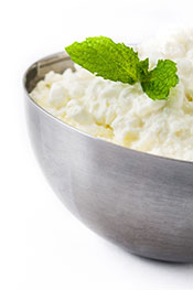 A Metal Bowl Containing Cottage Cheese.