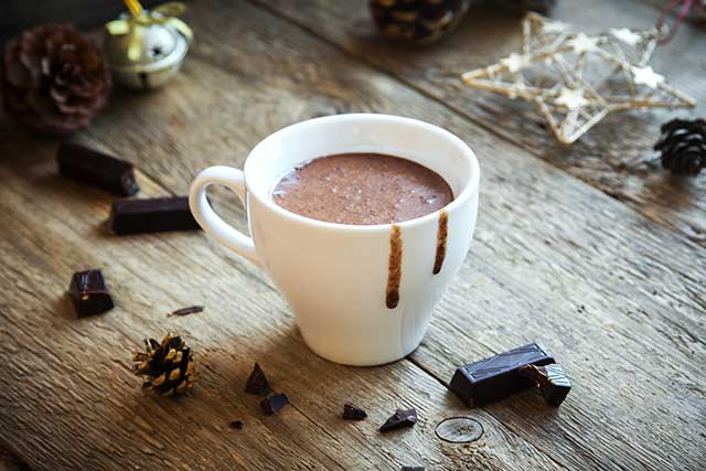 A Cup of Hot Chocolate (Cocoa) On a Wooden Table.