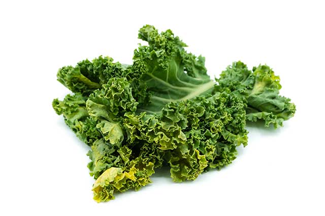 Dark Green Whole Kale Leaves on a White Background.