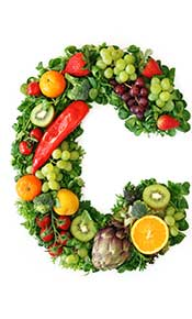 Foods High In Vitamin C Spelling a Giant 'C' Shape.