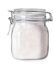 A Glass Jar of Granulated Allulose Sweetener.