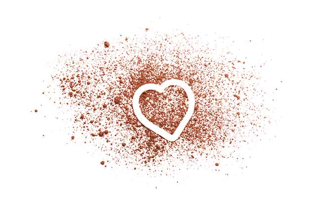 Cocoa Powder Made Into the Shape of a Heart.