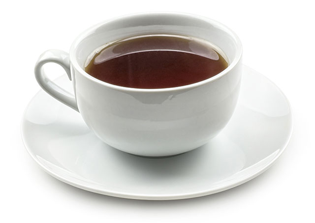 A Hot Cup of Black Tea In a White Cup With White Saucer.