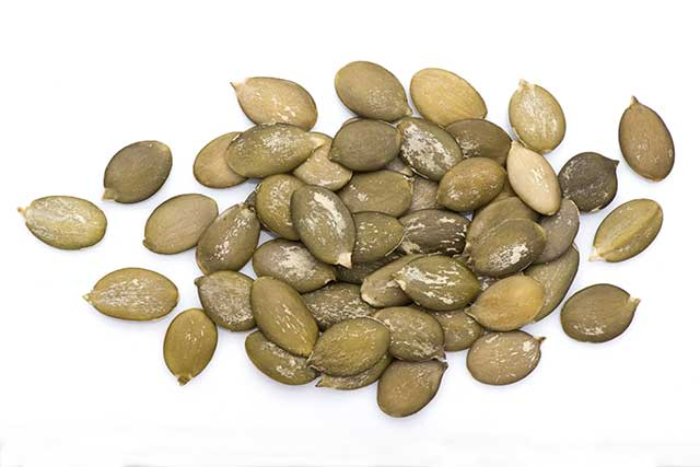 A Pile of Pumpkin Seeds On a White Background,