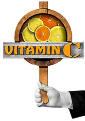 """A Sign Saying """"Vitamin C"""" and Showing Oranges and Lemons."""