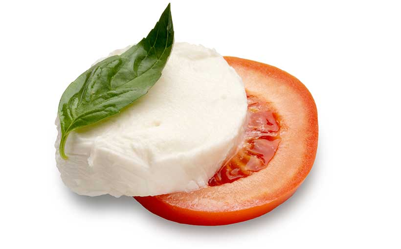 A Slice of Low-Fat Mozzarella On Top of a Slice of Tomato.