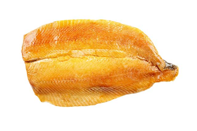 A Smoked Kipper Fillet On White Background.