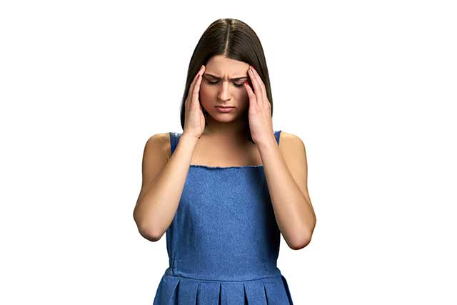A Young Woman With a Migraine Headache.