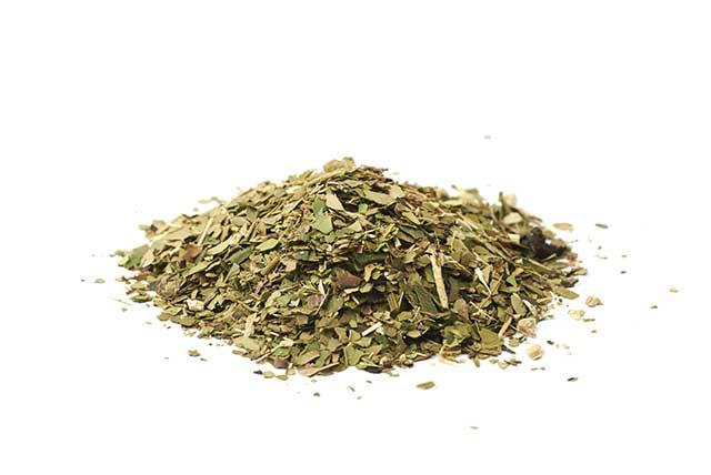 A Pile of Green Dried Yerba Mate Tea Leaves.