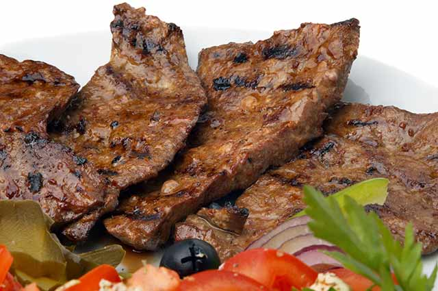 Fried Beef Liver On a Plate With vegetables.