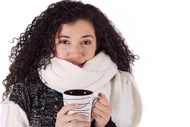 Happy Girl Drinking a Cup of Yerba Mate Tea.