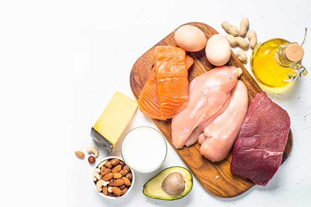 Ketogenic Diet Foods On Table - Meat, Fish, Nuts, Cheese, Oil.