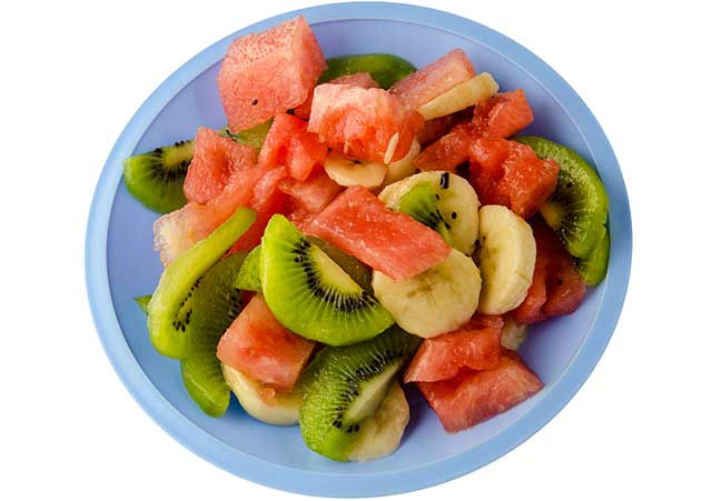 Mixed Fruit On a Plate - Berries, Banana, Kiwi, Watermelon.