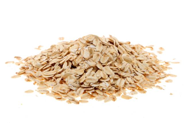 A Pile of Oat Flakes On a White Background.