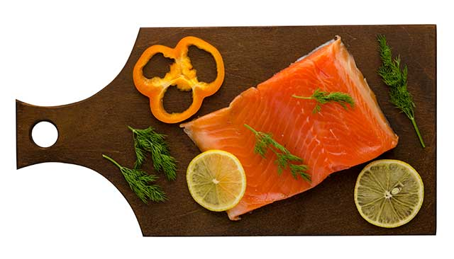 Red Fillet of Trout On a Wooden Board With Lemon Slice.