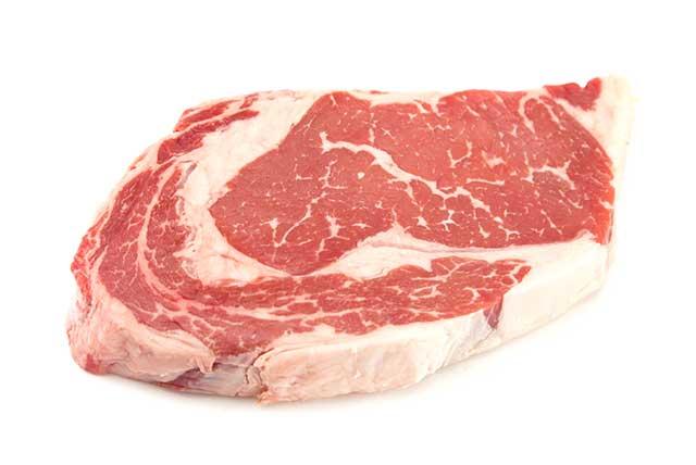 A Thick Raw Rib-eye Steak With Marbling