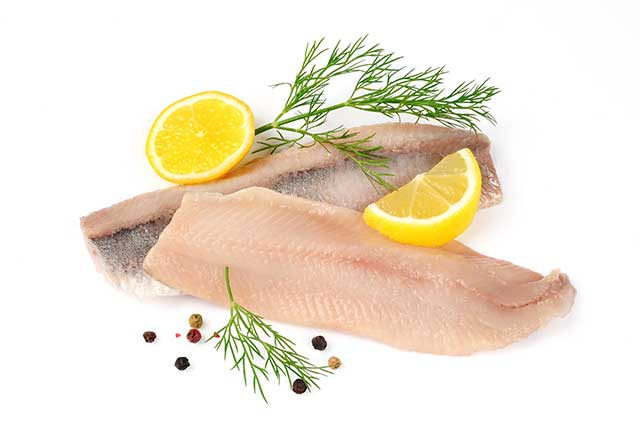 Two Herring Fillets With Lemons and Herbs.