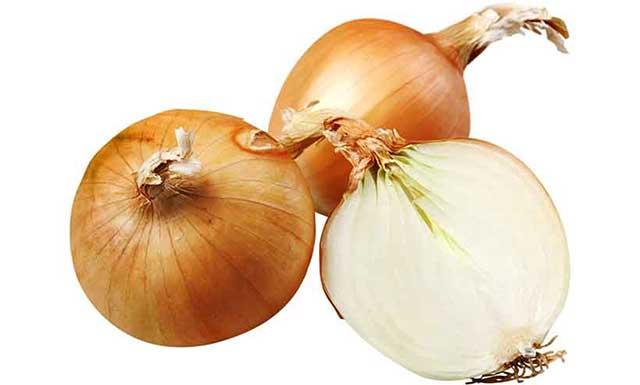 A Whole Yellow Onion and Onion Halves.