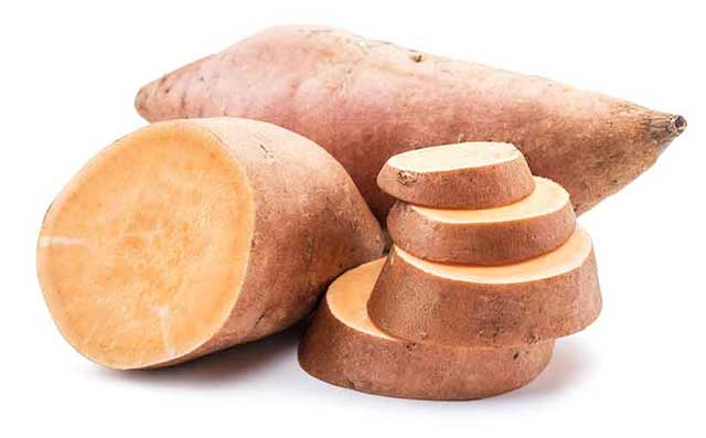 A Whole Sweet Potato, Half, and Slices.