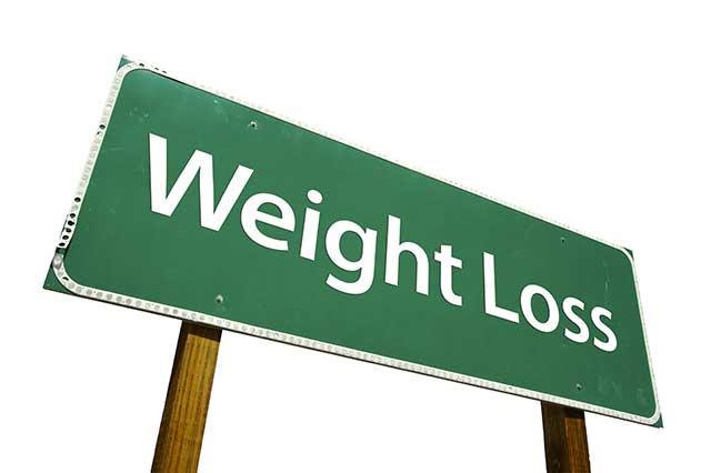 "A Green Road Saying Saying ""Weight Loss""."