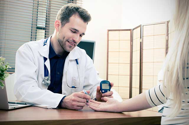 A Doctor Testing The Blood Glucose of a Patient.