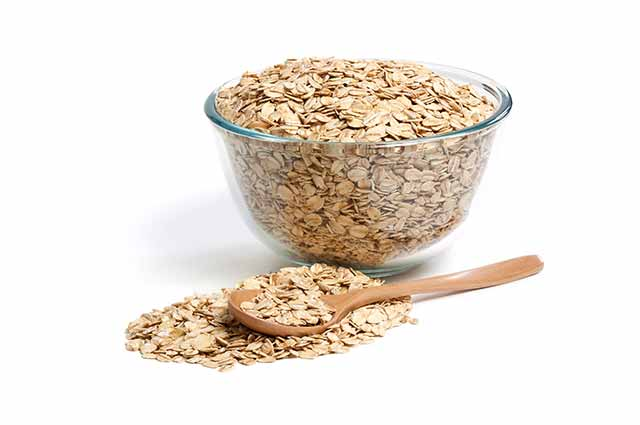 Raw Oats In a Glass Bowl.