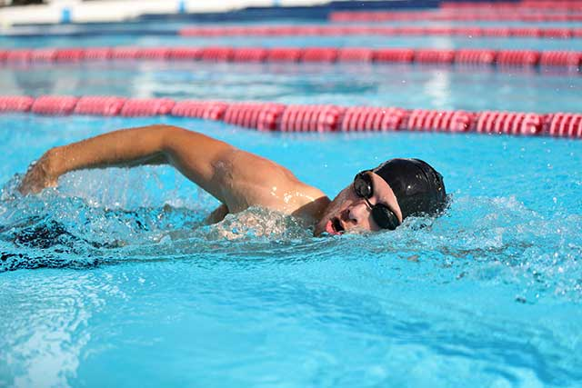 A Professional Swimmer In the Middle of a Race.
