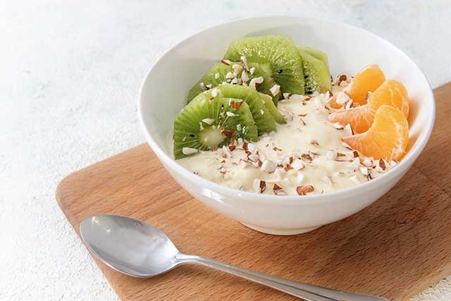 A High-Protein Breakfast Dish Featuring Quark. Nuts and Fruit.