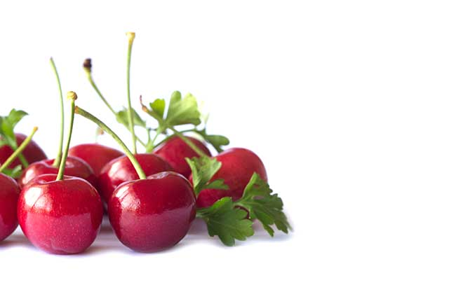 Red Cherries With Green Stems.