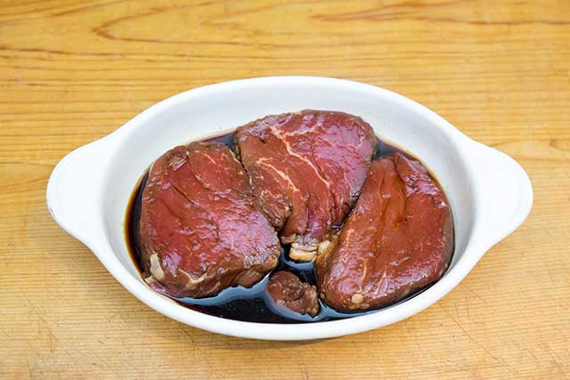 Steak Marinating In Soy Sauce, Olive Oil, and Red Wine.