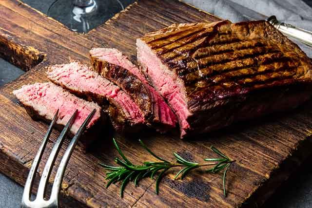 Tenderloin Steak On a Wooden Chopping Board.