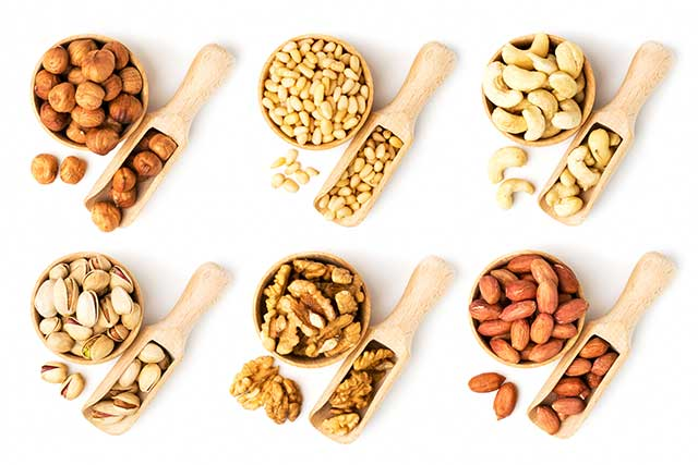 Various Nuts in Wooden Dishes.