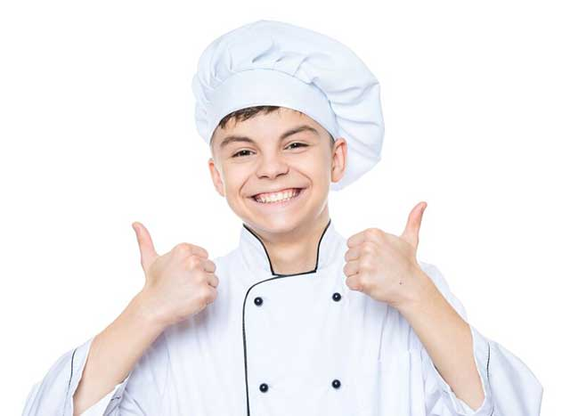 Boy Dressed As a Chef Giving Two Thumbs Up.