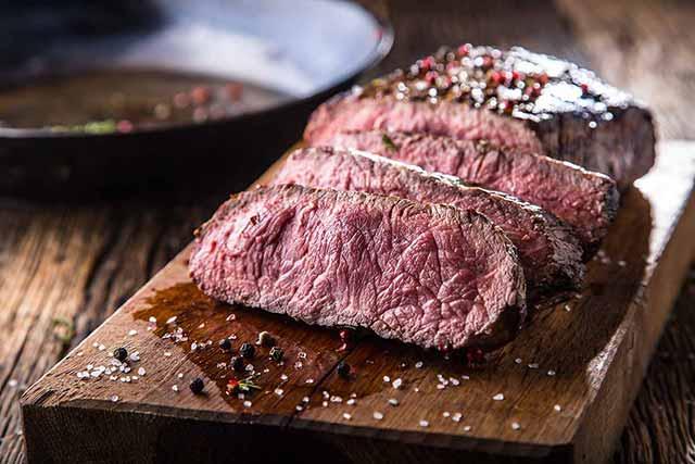 Chopped Bison Meat Steak On a Wooden Board.