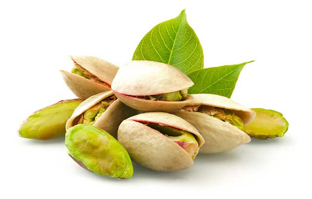 Green Pistachio Kernels and Nuts In Their Shell.